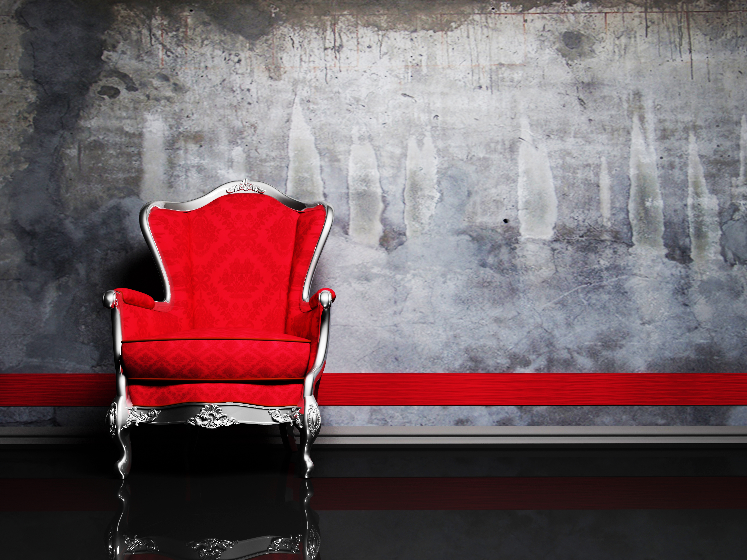 This is a modern interior with a red classic armchair on the dirty background